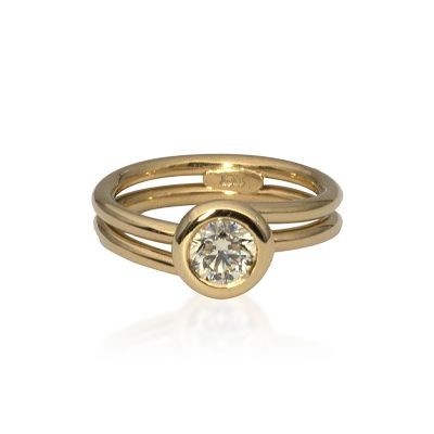 18ct gold double band design solitaire ring with a bezel set diamond